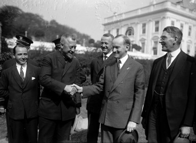Hugo Eckener being greeted by U.S. President Calvin Coolidge after the successful transatlantic delivery flight of LZ-126.