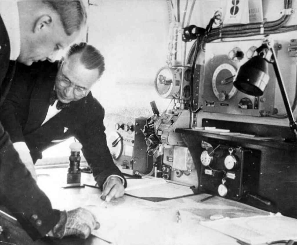 Ernst Lehmann and Knut Eckener examining charts in Hindenburg's Navigation Room. (The eyepiece of the Zeiss drift measuring telescope can be seen beneath Lehmann's shoulder.)