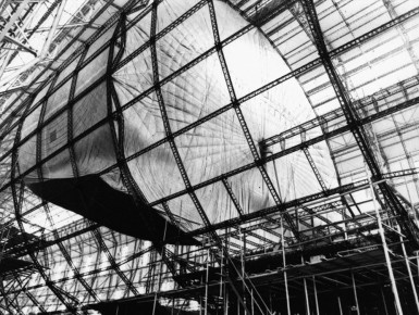 Hindenburg under construction, showing the axial catwalk passing through the center of a gas cell, and the outline of the passenger compartment at lower right.