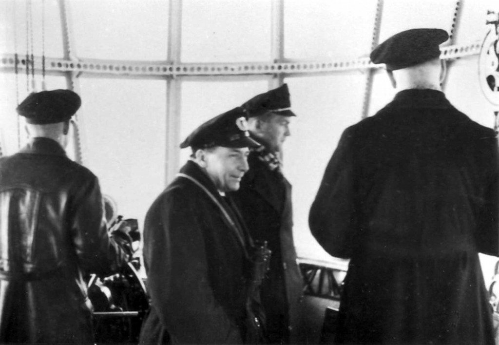 Captain Ernst Lehmann (center), Captain Heinrich Bauer (right), and Watch Officer Knut Eckener (far right) in Hindenburg's Control Room